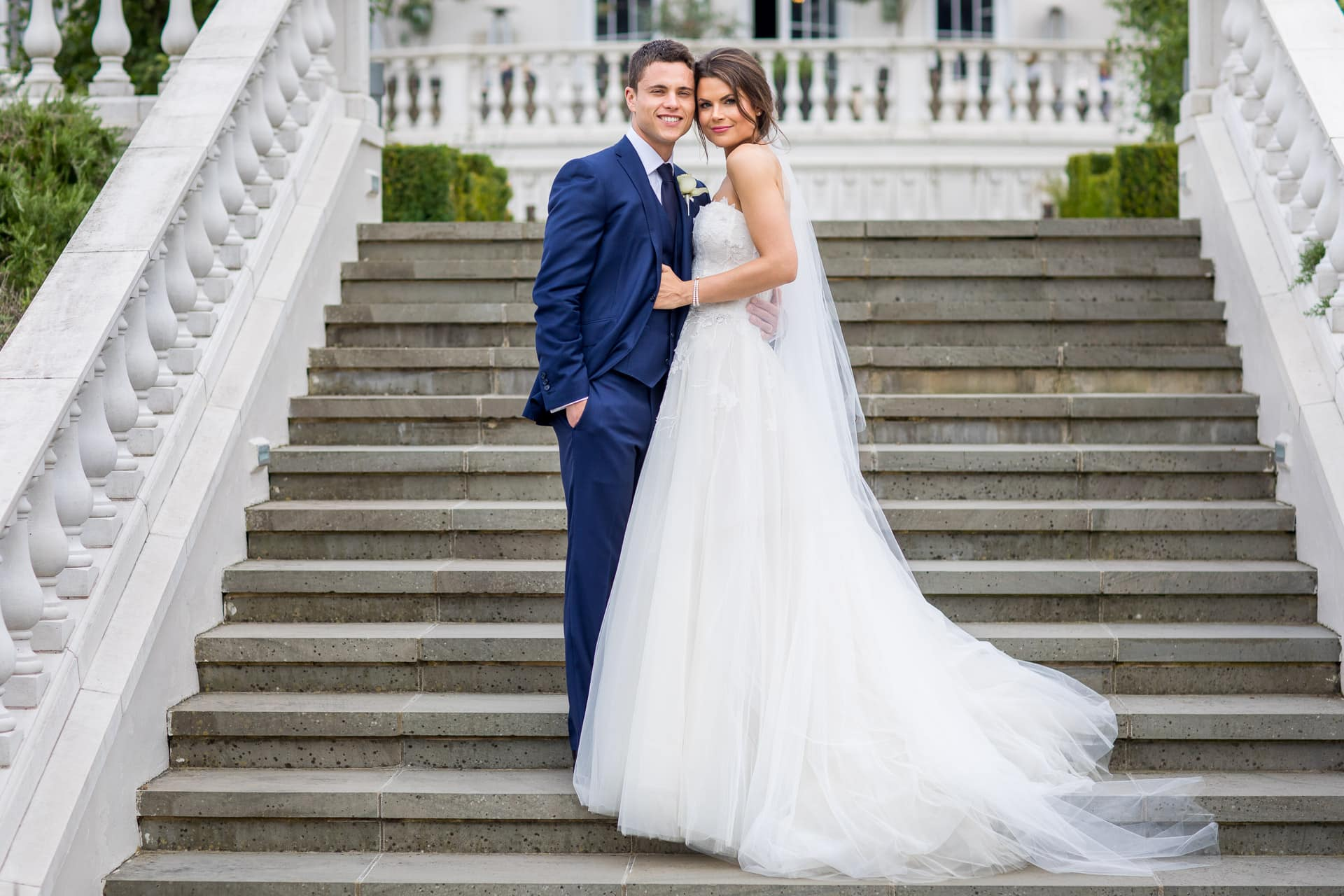 wedding couple on the steps of Coworth Park