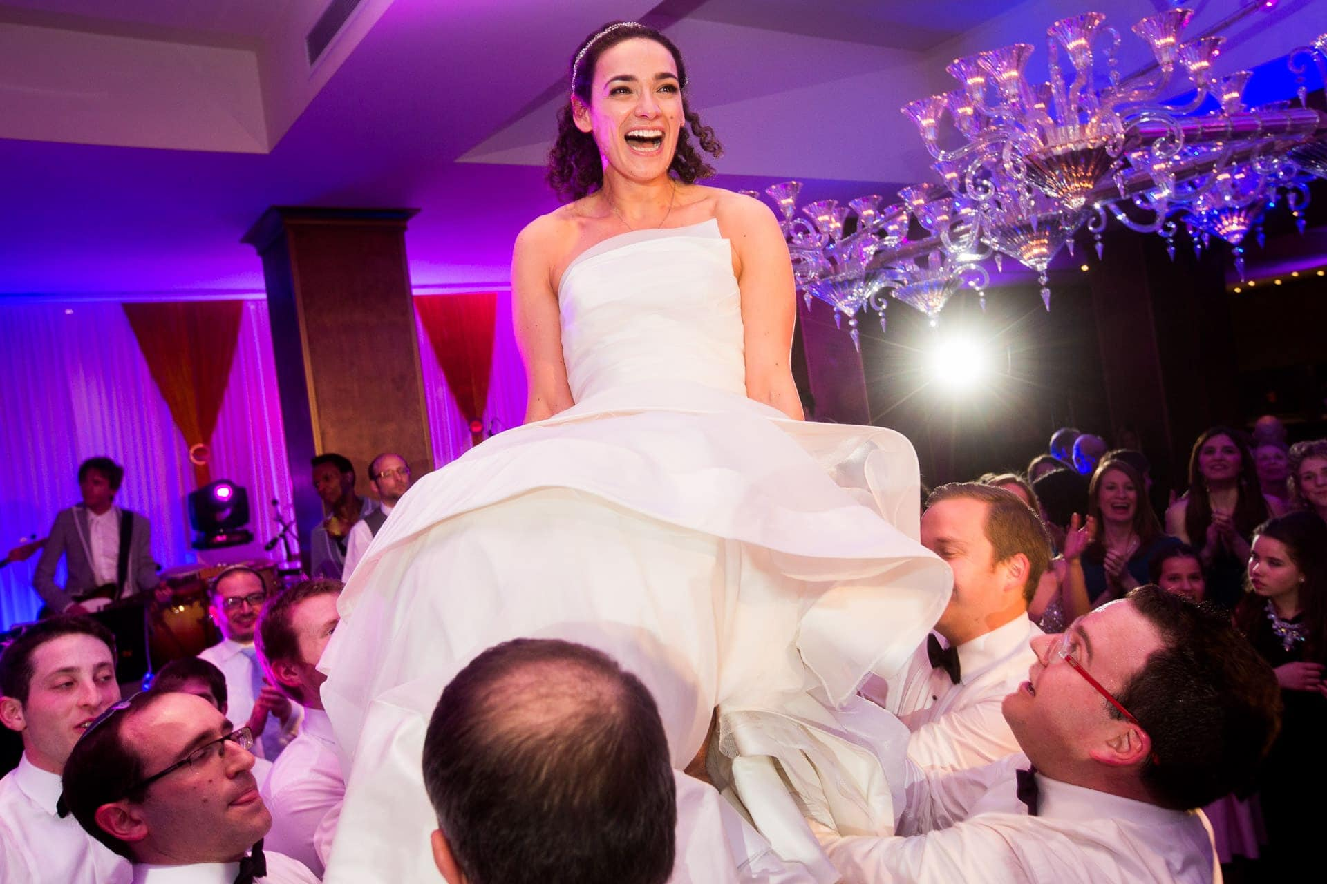 Jewish bride up on a chair